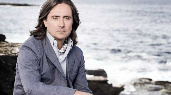 Neil Oliver hosts the TV series Coast Australia.
