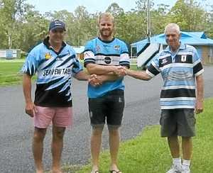 SO IT BEGINS: Club vice-president Gavin Hann, Adam Slater and Peter Brown launch Woolgoolga's season.