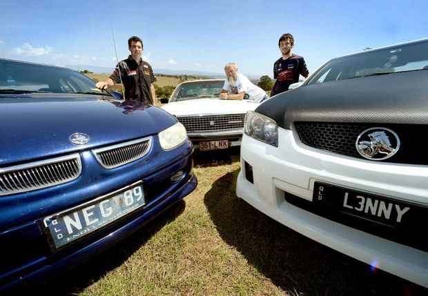 CAR OF CHOICE: Ted Griffiths (centre), pictured with sons Nathan Griffiths and Lenny Griffiths, are among the many Holden Commodore fans in Ipswich.
