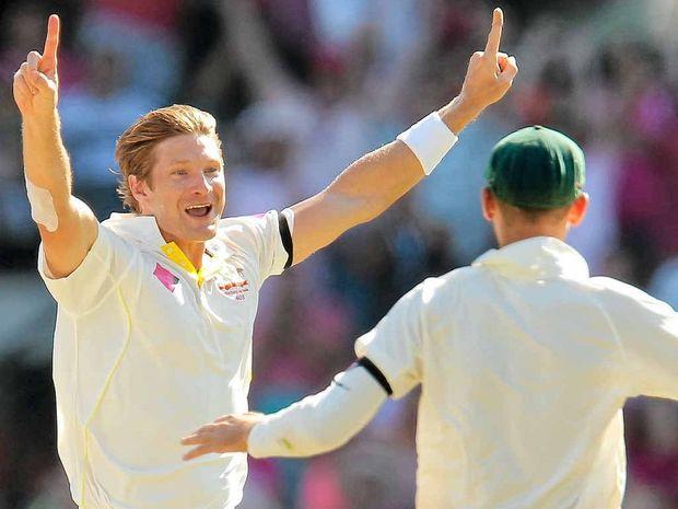 GOT HIM: Shane Watson celebrates after claiming the wicket of Suresh Raina.