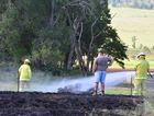 Fire Fighters watch over the lawnmower which sparked the blaze.
