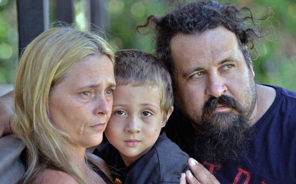 ESCAPE ARTIST: Aiden Buckley, 5, with his parents Sharon Gardner and Michael Buckley.