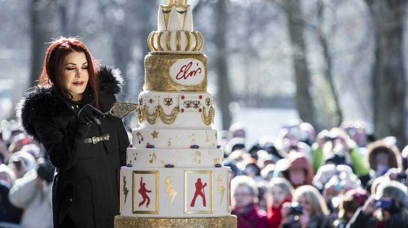 HAPPY BIRTHDAY ELVIS: Priscilla Presley cuts an eight-tiered birthday cake during the 80th birthday celebration for her late ex-husband Elvis Presley at Graceland on Thursday.