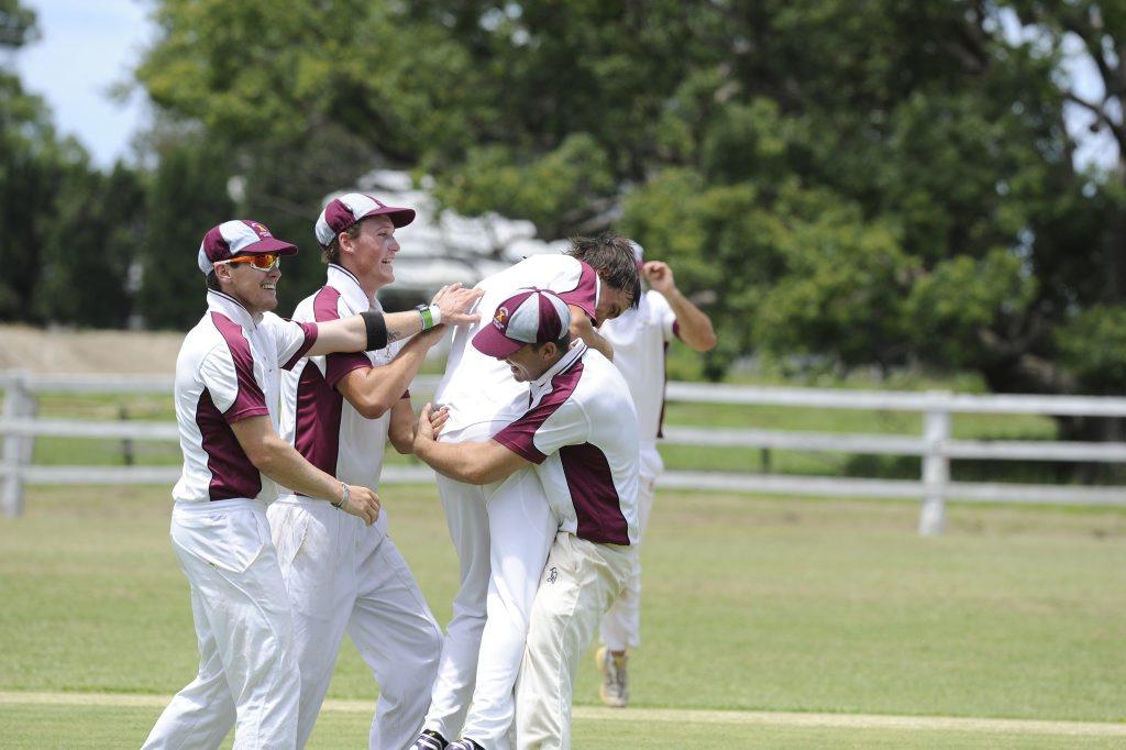 HAT-TRICK HERO: Brothers bowler Jack Weatherstone is mobbed by teammates against Westlawn at Ulmarra on Saturday. Photo: Debrah Novak / The Daily Examiner