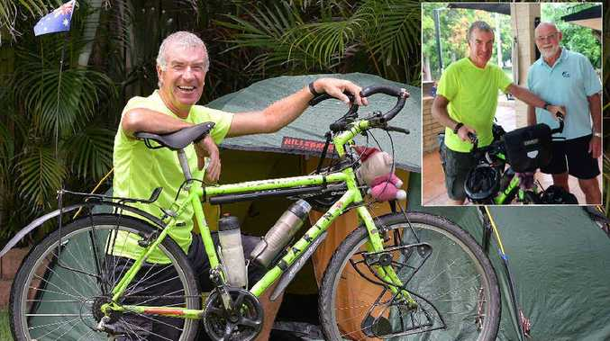 WORLD TOUR: Global cyclist Jeremy Reed stops over in Mackay after catching up with fellow adventurer Pat Wells (inset) at Dingo Beach.