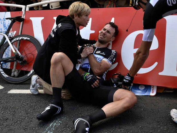 CRUEL BLOW: Great Britain's Mark Cavendish receives medical assistance after falling near the finish line at the end of the first stage of last year's Tour de France.