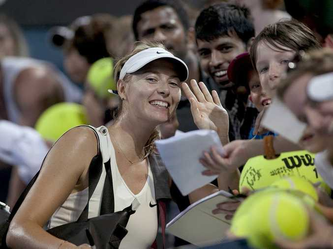 Maria Sharapova with some of her fans at the Brisbane International tennis tournament.