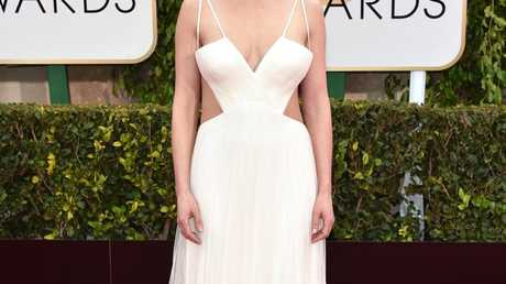 Rosamund Pike arrives at the 72nd annual Golden Globe Awards wearing a Vera Wang gown.
