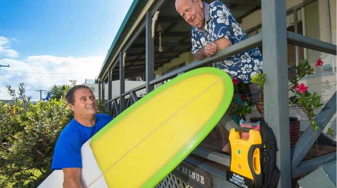 BETTER SAFE THAN SORRY: Woolgoolga Longboard Club secretary Marty Curry and resident Laddie Mackenzie, who will be housing the defibrillator.