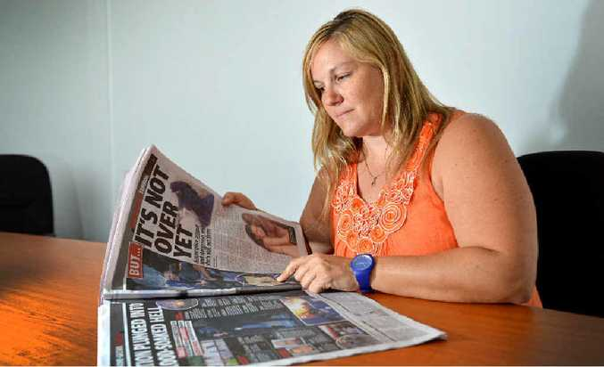 SHOCKING: Gympie's Caroline Vielle looks over newspaper coverage of the string of terrorist attacks in Paris, France.