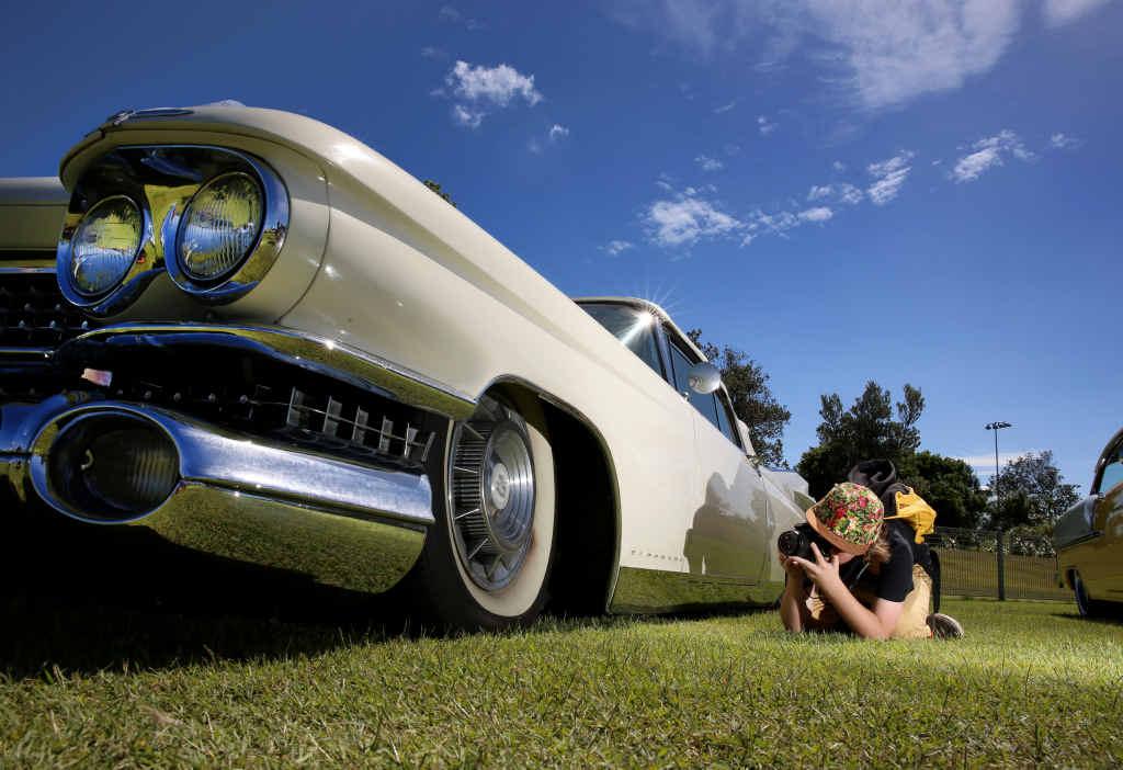 Aspiring photographer Roy Czislowski gets down low to take a photo.