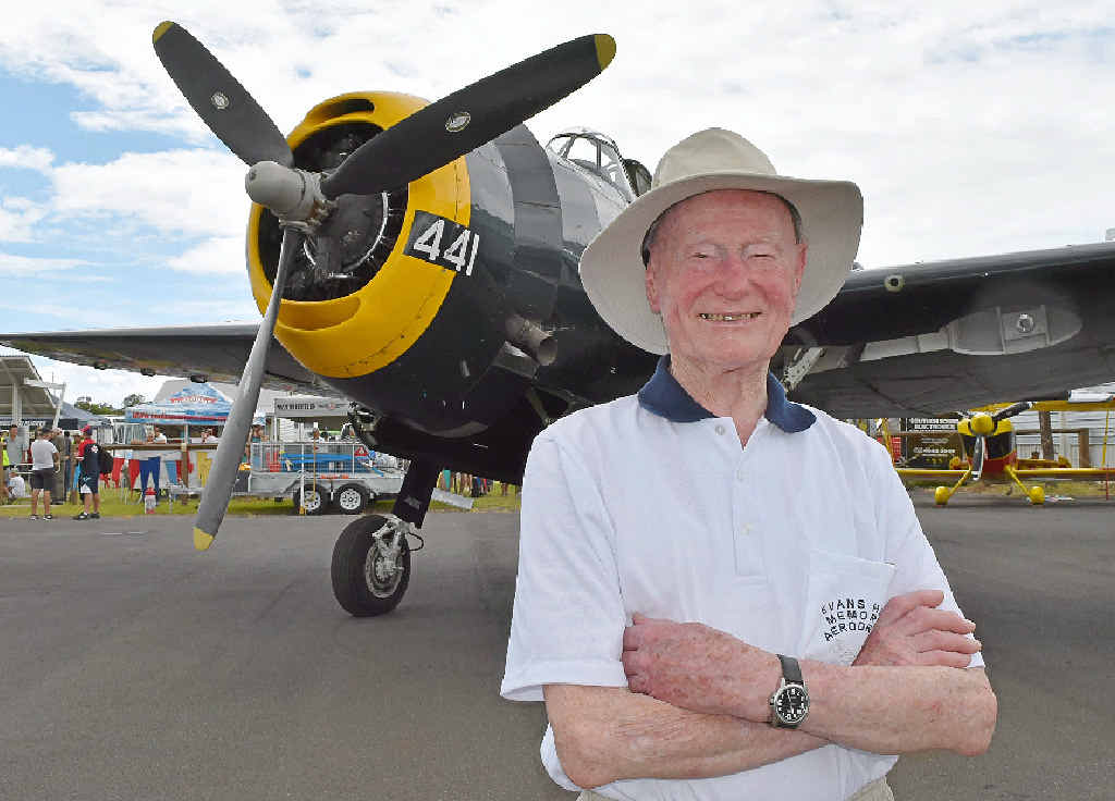 BATTLE STORIES: Second World War veteran Jack Bell stands in front of a WWII Avenger 441 plane at the Evans Head Great Eastern Fly-In on Saturday.