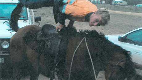 DARE DEVIL: Kurtis West shows off his spirit as he 'planks' on a horse.