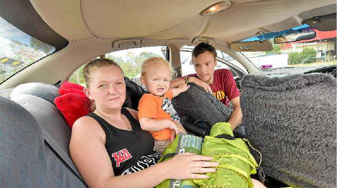 HOMELESS: Eddie Pyke and his partner Jasmine Hopkins with their son, Slater, 17 months. The family has been living in their car, camping and couch surfing.
