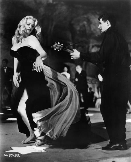 Anita Ekberg dancing to guitarist in a scene from the film 'La Dolce Vita', 1960
