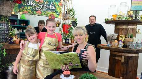 CAKE GARDEN: Amber Collins is the owner of new market caf , the Cake Garden. Pictured here with her family Pearl, Graycie, Patrick and Pacer Collins. Photo taken on Monday, 12 January 2015. Photo: Max Fleet / NewsMail