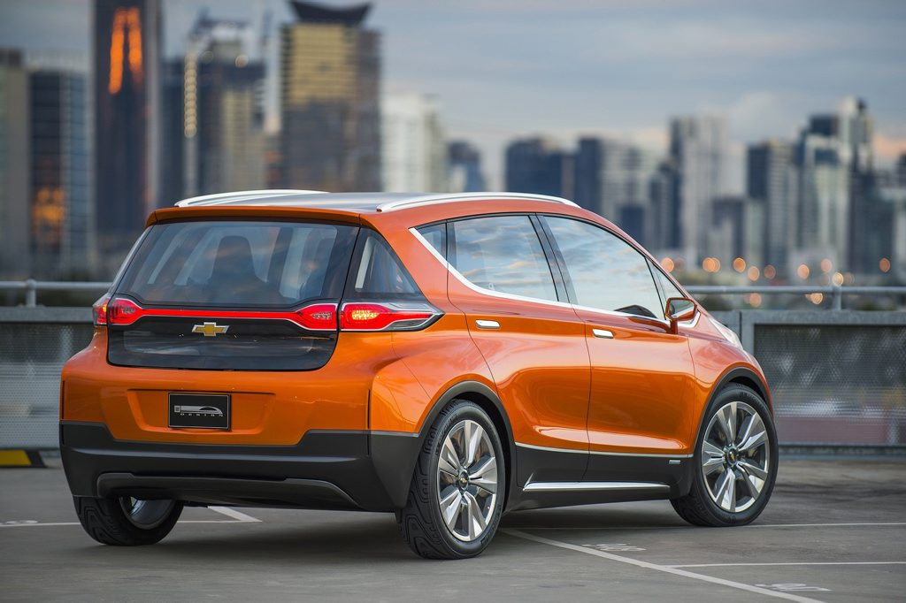 2015 Chevrolet Bolt EV Concept all electric vehicle. Rear in city scape. Bolt EV Concept builds upon Chevy's experience gained from both the Volt and Spark EV to make an affordable, long-range all-electric vehicle to market. The Bolt EV is designed to meet the daily driving needs of Chevrolet customers around the globe with more than 200 miles of range and a price tag around $30,000.