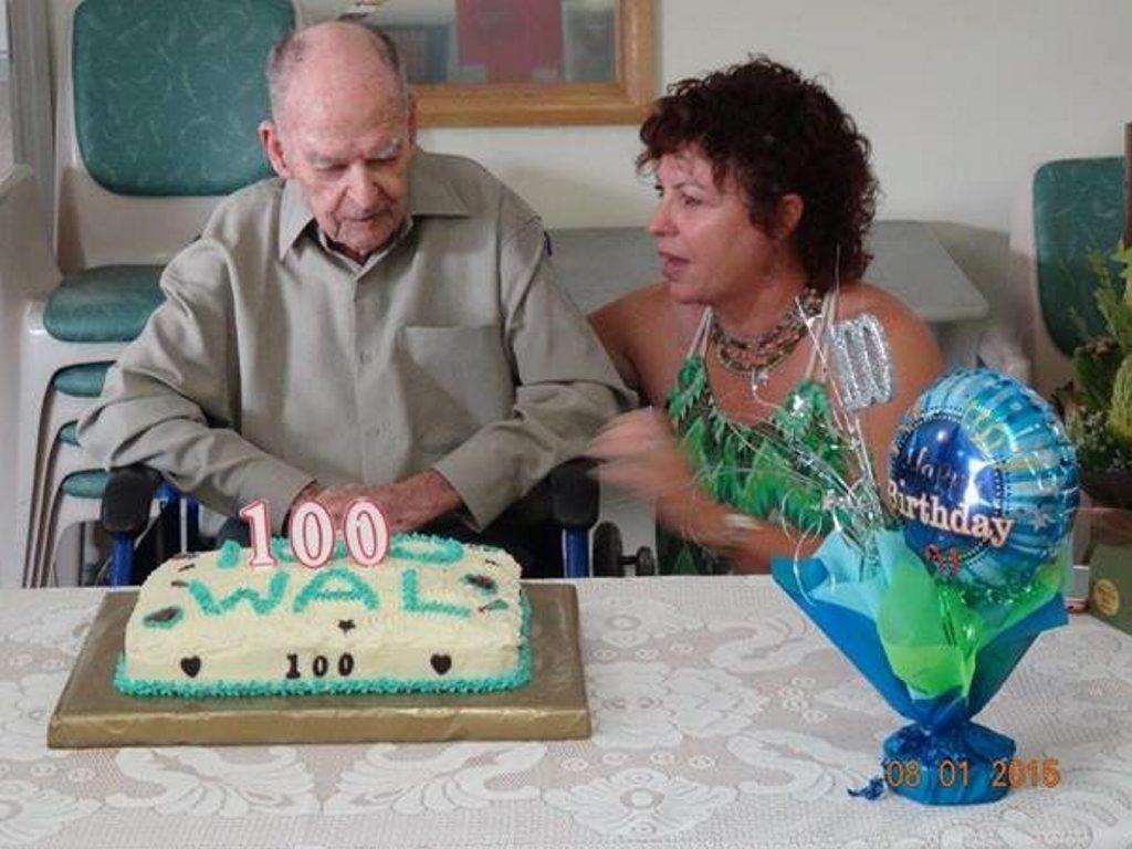 Walter Davidson at his 100th birthday party with his granddaughter Karen Blackburn.