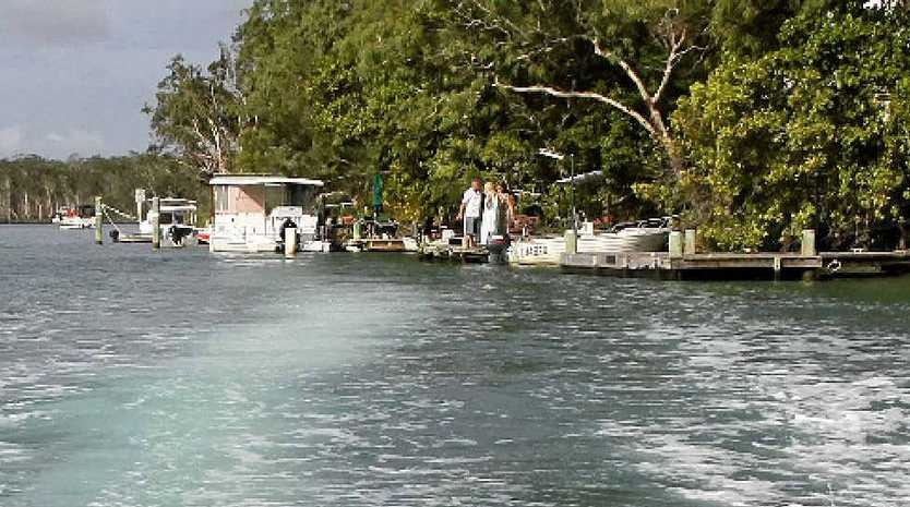 CAUSING DAMAGE? The wave from a powerboat on Noosa River at Tewantin.