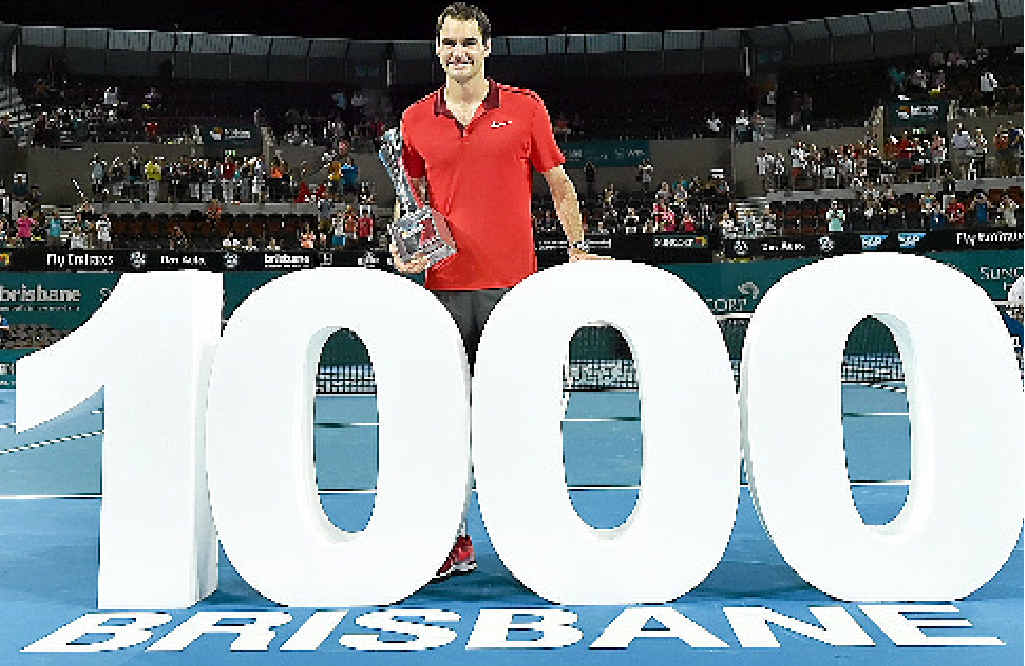 TOP OF THE PILE: Roger Federer celebrates the 1000th victory of his career after winning the Brisbane International.