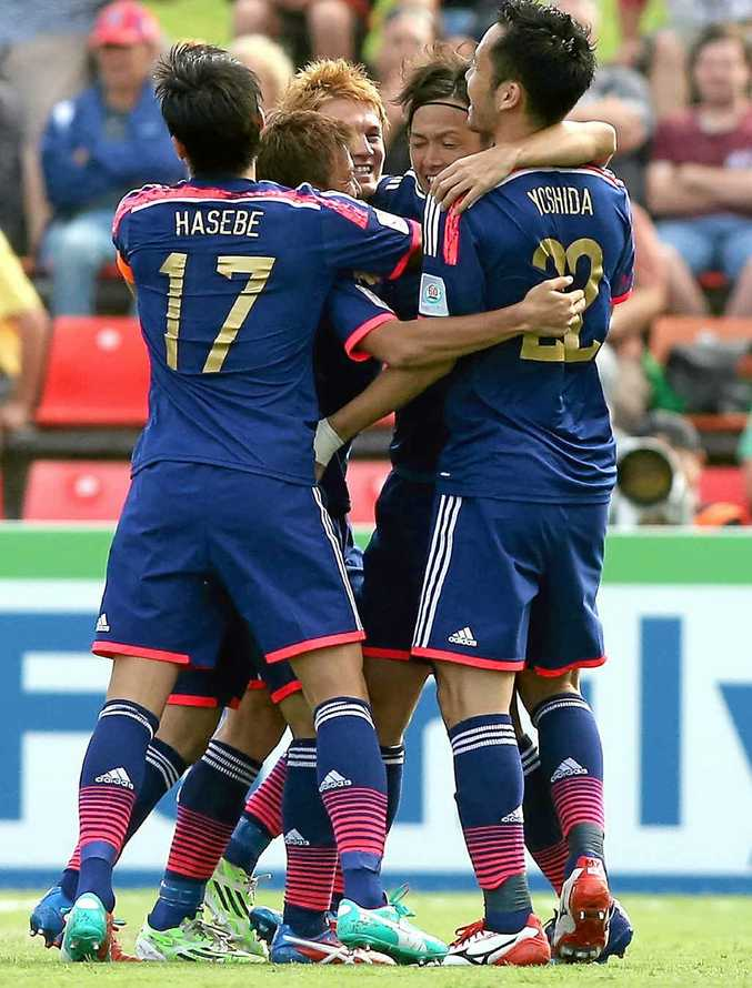 GOAL TIME: Japanese players celebrate one of their four goals against Palestine.