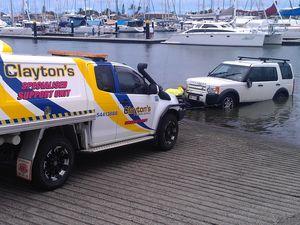 Panic as car takes a dive into Mooloolaba marina