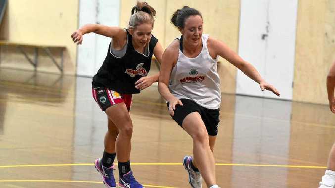 Mackay Meteorettes Dani Fair with Lisa-Jane Millard in white, who is leaving to play netball.