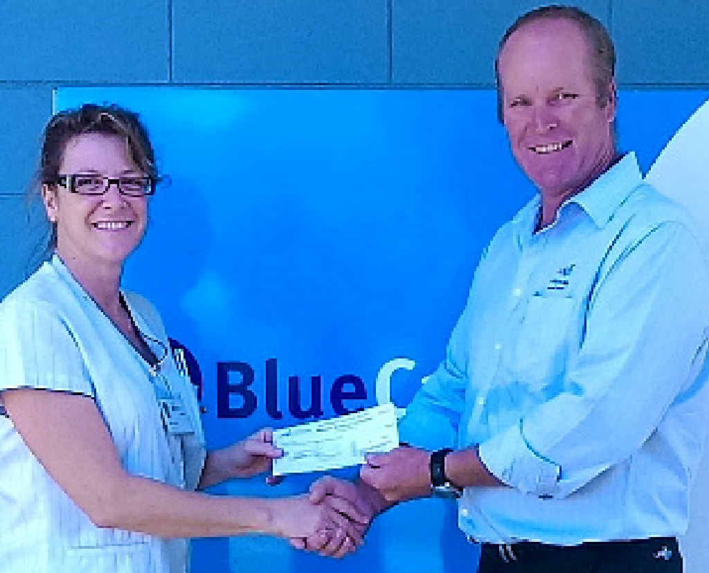 GENEROUS DONATION: Blue Care representative Laura Veal receives the cheque from Ron Drew Charity Golf Day organiser Kelvin Stephens.