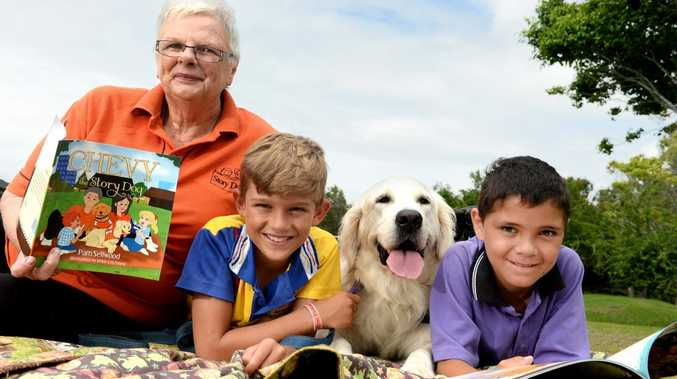 Pam Sellwood, Blake Nelson (St Anthony's Kingscliff), Chevy and Ned Atkins (Pottsville Beach Public School) read the new book abouy Chevy the story dog. Photo: John Gass / Tweed Daily News