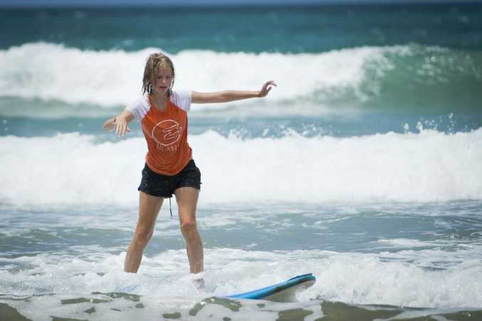Anna Meikle, 13, rides the waves at SUNfest in Agnes.