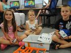 Having fun at the Robogals workshop at the Highfields Library are (from left) Talia Sharpe, Sienna Schmaling and Ryley Schmaling.