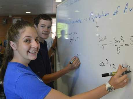 Maths B Preparation Camp students Jessica Gardner and Matthew Schmidt practice their problem solving at Toowoomba Grammar School.