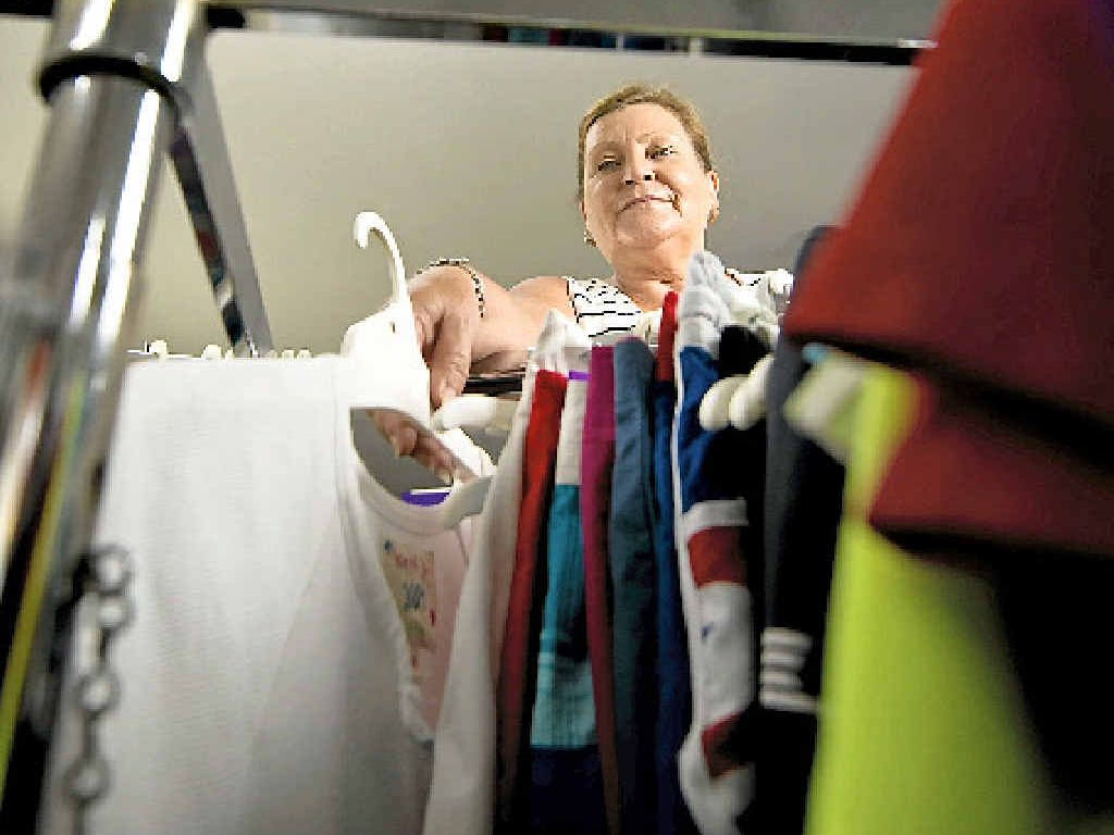 CLOSING UP: Stocking the racks for the last time, Catherine Biram will shut the Endeavour Foundation's Recycled Clothing store doors on January 30.