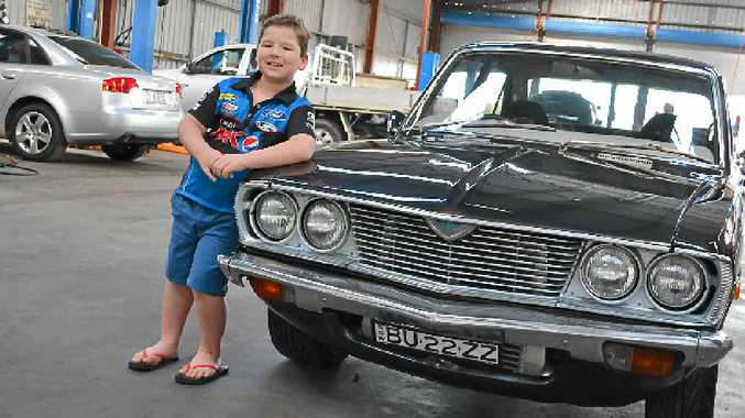 Cooper Crowley with his uncle's Mazda RX-2