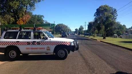BLOCKED FOR SAFETY: The SES is assisting police to keep the public away from the emergent area in Haly St.