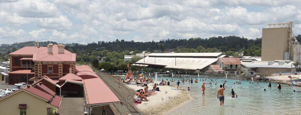 Digitally manipulated image of Toowoomba railway precinct with a beach included.