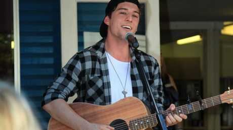 The X Factor finalist Taylor Henderson sings for clients of the Community Lifestyle Agency.