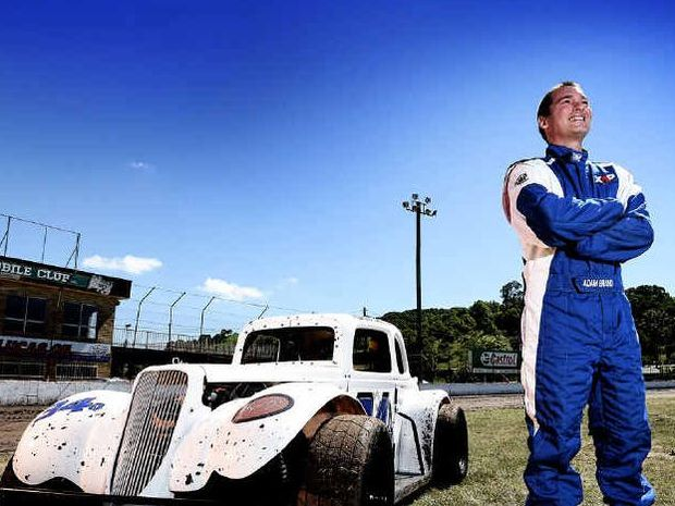 REVVED: Country music star Adam Brand will race this weekend at the Lismore Speedway.