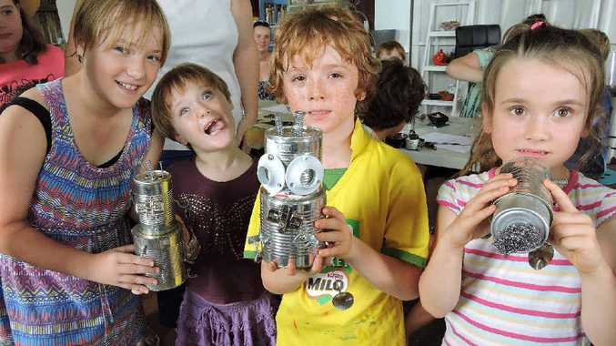 SHOWING OFF: Kelsea Thomson, 10, Vienna Thomson, 4, Jarrod Jones, 9, and Holly Jones, 7, proudly display their robot sculptures at the robot building workshop at Paxtons Creative Space.