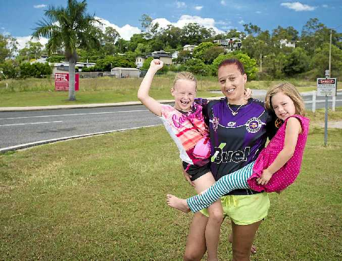 HAPPY: Stoked neighbours of Aldi Supermarket, Cathy Langridge and her two girls Matilda, 7, and Destiny Miers, 4.