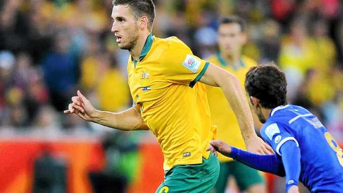 KEY MAN: Matthew Spiranovic in action against Kuwait.