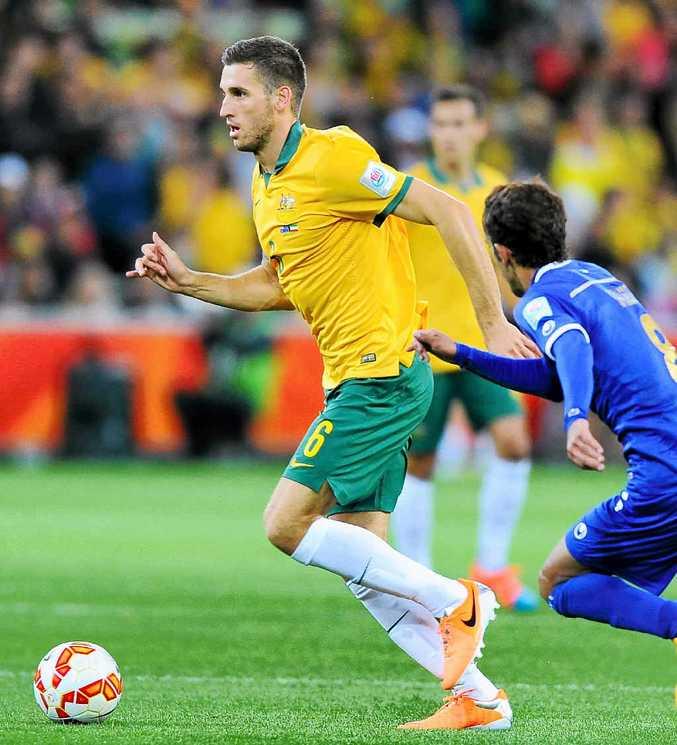 KEY MAN: Matthew Spiranovic in action against Kuwait.