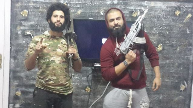 Australian ISIS member Suhan Abdul Rahman holds a silver-plated AK-47 with fellow Australian extremist Mohamed Elomar