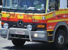 Fire fighters at scene of house fire in North Rockhampton