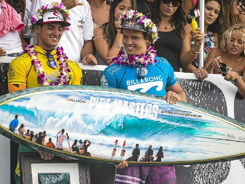 PROUD MOMENT: Brazil's Gabriel Medina and Australia's Julian Wilson receive their awards at the Billabong Pipe Masters in Haleiwa, Hawaii.