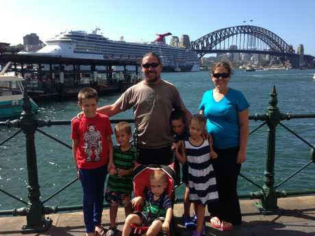 Andrew Stevenson (centre) enjoys a trip to Sydney with his partner Jacqui Courte and their children (from left) Nathaniel, Deklan, Iggy, Austin and Helayna.
