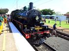 FULL STEAM: Train enthusiasts congregate at Bundaberg station as Queenslandrail celebrates 150 years of rail in Queensland. Photo: Max Fleet / NewsMail