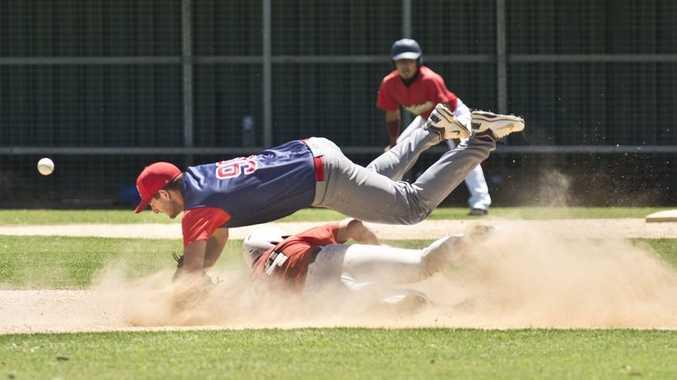 LEAP FROG: Rangers infielder Phil Vanderneut tries to get the ball as Indians base runner Gareth Jones slides to second base.