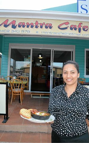 MOVING ON: Reena Gamble of Yamba's Mantra Cafe with her spicy beans and baked eggs breakfast which had her establishment in the running for Australia's 2014 Cafe of the Year crown. Photo: Georja Ryan