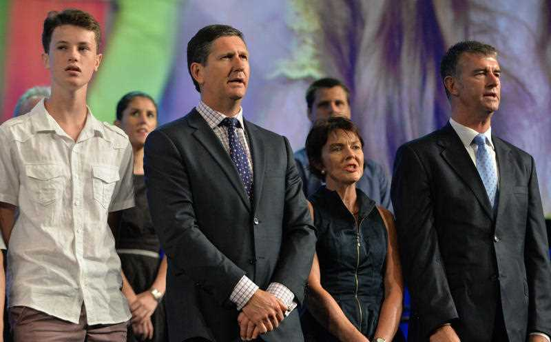 Queensland Minister for Health Lawrence Springborg (2nd L) sings the national anthem during the official launch of the Liberal-National Party (LNP) election campaign in Brisbane, Qld, Sunday, January 18, 2015.